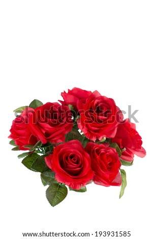 Bouquet of artificial red roses, isolated, space for copy on the top.