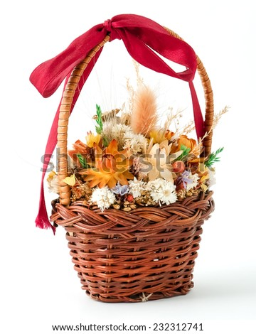 bouquet of autumn flowers in basket isolated on white  - stock photo