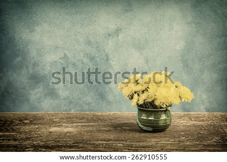 Bouquet of beautiful flowers on vintage background, home decor in a rustic style - stock photo