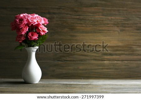 Bouquet of beautiful fresh roses on wooden background - stock photo