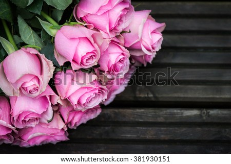 Bouquet of Beautiful Pink Roses on Dark Wooden Background, shallow DOF, selective focus - stock photo