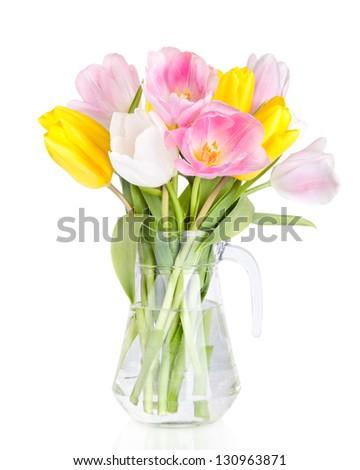 Bouquet of beautiful tulips flowers in vase isolated on white - stock photo