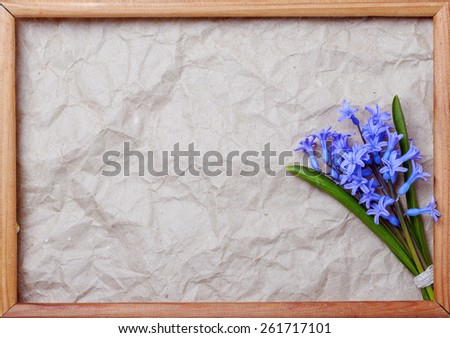 bouquet of blue hyacinths with space for text in a wooden frame