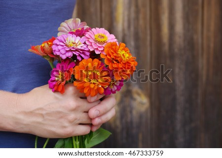Bouquet of bright summer flowers in in female hands. Festive bouquet