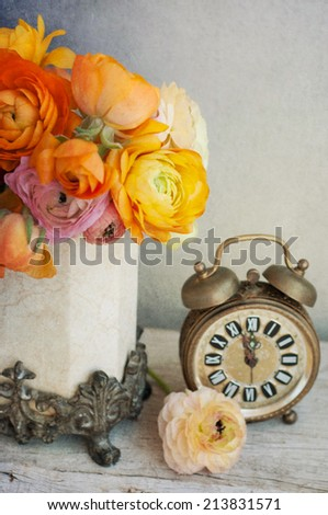 Bouquet of buttercup flowers (ranunculus) on wooden table  - stock photo