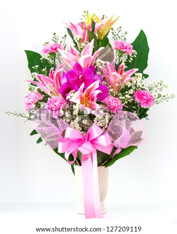 Bouquet of canation lily and orchid in a vase - stock photo