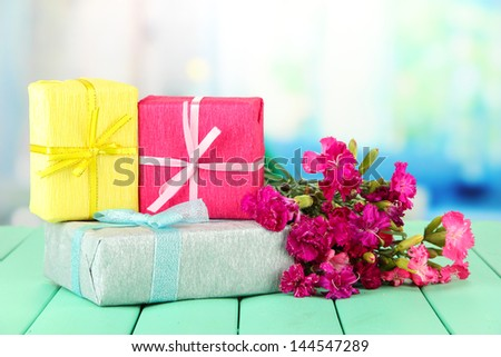 Bouquet of carnations, on color wooden table, on bright background