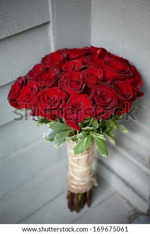 Bouquet of classic red roses for Valentines Day or wedding - stock photo