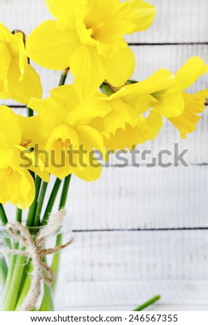 Bouquet of colorful daffodils on the boards, flowers close up - stock photo