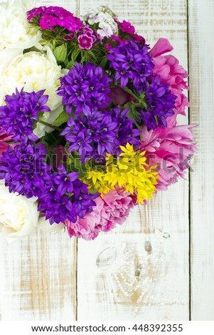 bouquet of colorful flowers on white wooden planks