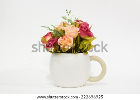 Bouquet of colorful roses in white vase - stock photo