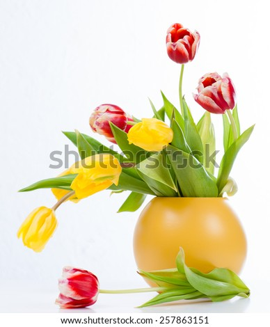 bouquet of colorful tulips in vase - stock photo