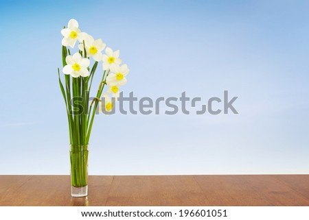 Bouquet of daffodils against blue sky