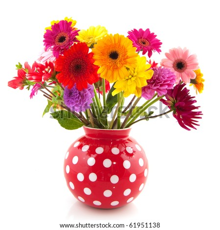Bouquet of Dahlia flowers in red dotted vase - stock photo