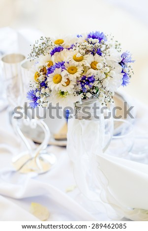 Bouquet of daisies on white table - stock photo