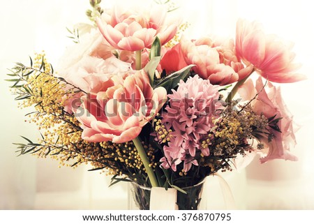 Bouquet of different flowers including tulips and mimosa - stock photo