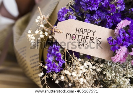 Bouquet of dried flowers with mothers day card on the wooden table