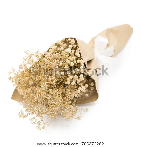 Bouquet of dried flowers wrapped paper on a white background.