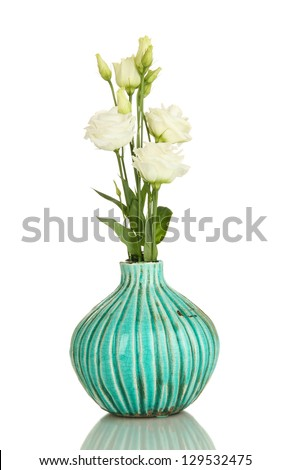 Bouquet of eustoma flowers in vase isolated on white - stock photo
