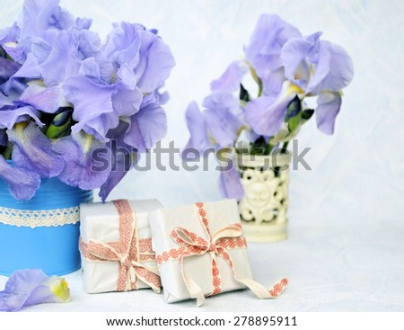 bouquet of flowers and a gift