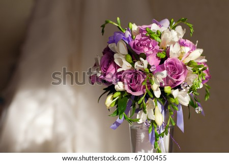 bouquet of flowers and wedding dress - stock photo