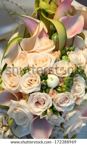 bouquet of flowers and wedding dress as background  - stock photo