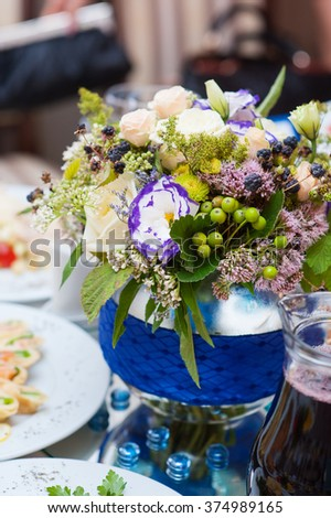 bouquet of flowers at the wedding table served. - stock photo