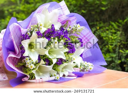 Bouquet of flowers consists of lilies and forget me nots - stock photo