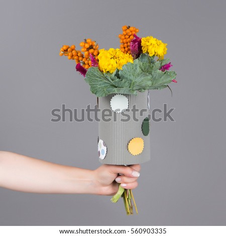 Bouquet of flowers for children with yellow flowers and berries
