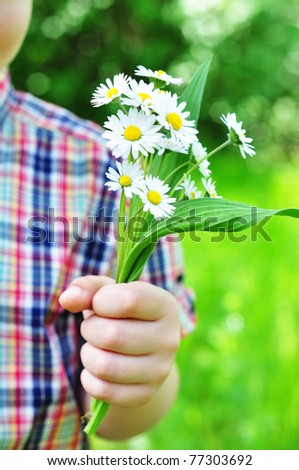 Bouquet of flowers for mommy in a child's hand - stock photo