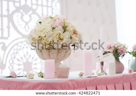 bouquet of flowers in a vase at the wedding table - stock photo