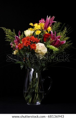 Bouquet of Flowers in a Vase Isolated on a Black Background - stock photo
