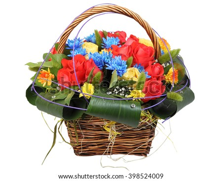Bouquet of flowers in a wicker basket, floral arrangement with red and yellow roses, blue chrysanthemums and yellow gerberas isolated on white background. - stock photo