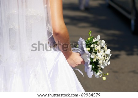 Bouquet of flowers in hands of bride