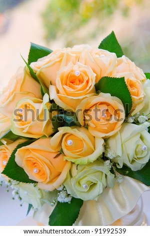 Bouquet of flowers in his hands the bride - stock photo