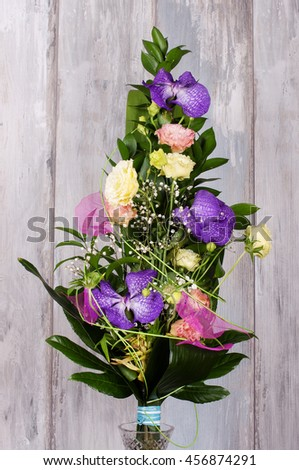 Bouquet of flowers isolated on reclaimed wood background