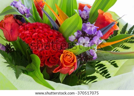 bouquet of flowers of different varieties. spring bouquet of bright flowers. close to the top. color image - stock photo