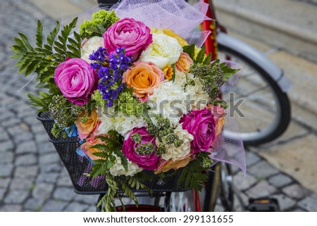 bouquet of flowers on a bicycle