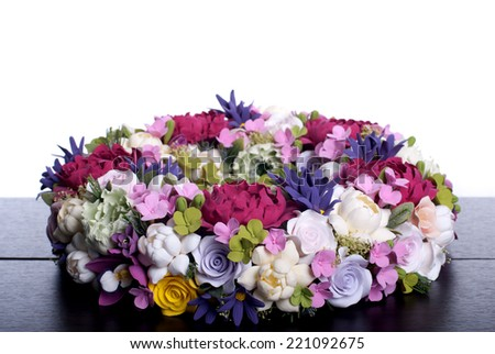 bouquet of flowers on a brown desk with isolated background