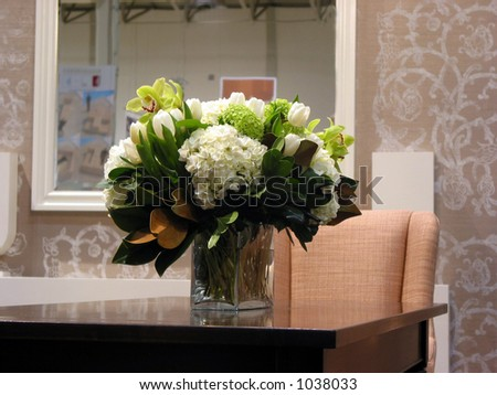 Bouquet of flowers on a table in a living room - stock photo