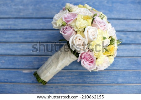 Bouquet of flowers, on blue wooden background - stock photo