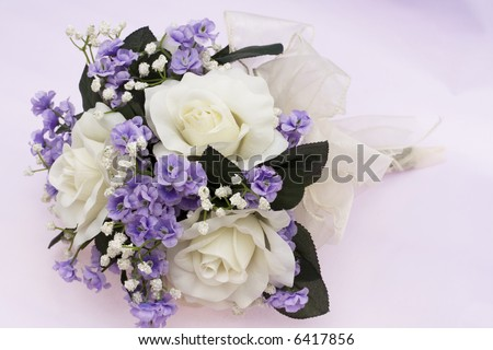 Bouquet of flowers on lavender background - stock photo