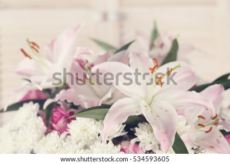Bouquet of flowers on light wooden background