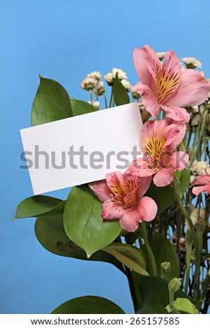 bouquet of flowers with a white card for the label. - stock photo