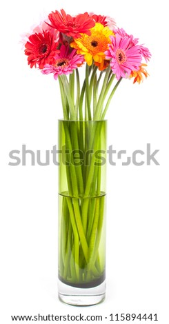 Bouquet of fresh colorful gerbera daisies in a green vase isolated on a white background. - stock photo