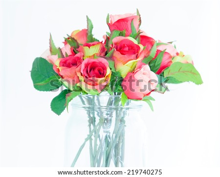 bouquet of fresh multicolored roses in vase - stock photo