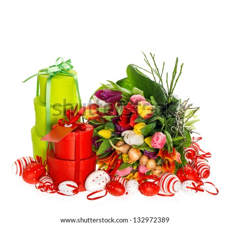 bouquet of fresh multicolored tulips with easter eggs and gift box on white background. festive decoration