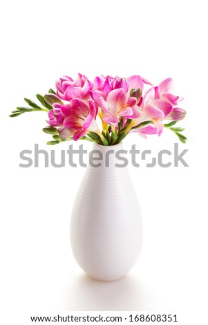 Bouquet of fresh pink flowers in a white vase - stock photo