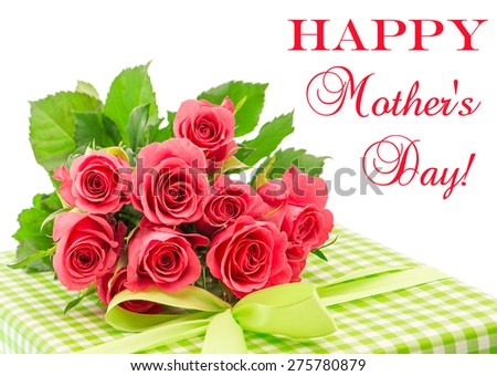 Bouquet of fresh pink roses with gift isolated on white background. Floral arrangement with sample text Happy Mother's Day! - stock photo