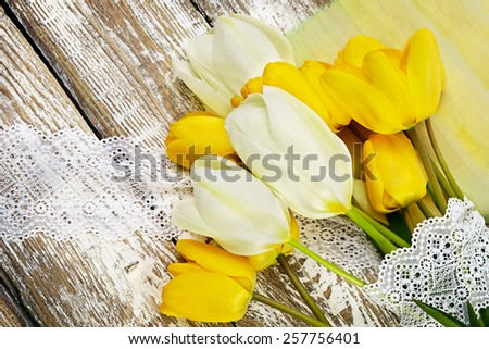 bouquet of fresh spring tulip flowers on wooden background - stock photo